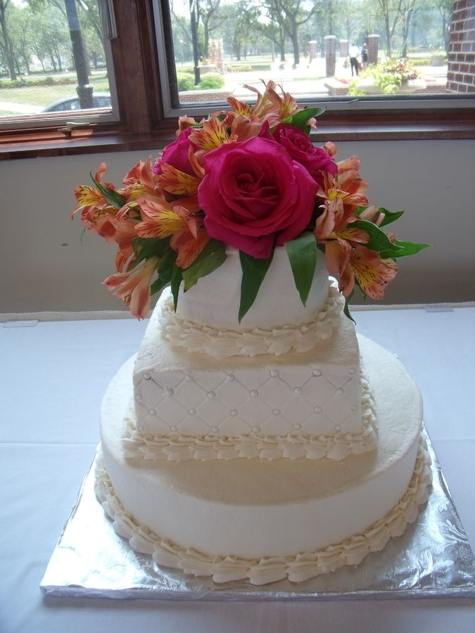 Buttercream cake with fresh flowers.