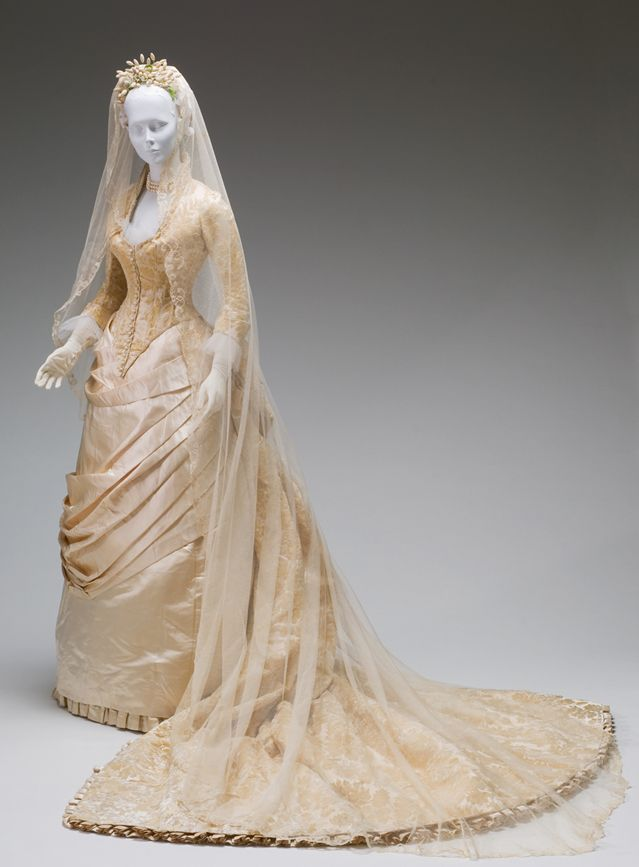 Victorian wedding dress - it was in the Victorian era that white wedding dresses became the norm rather than an oddity, thanks to Queen Victoria. I love the draping across the front of the dress.