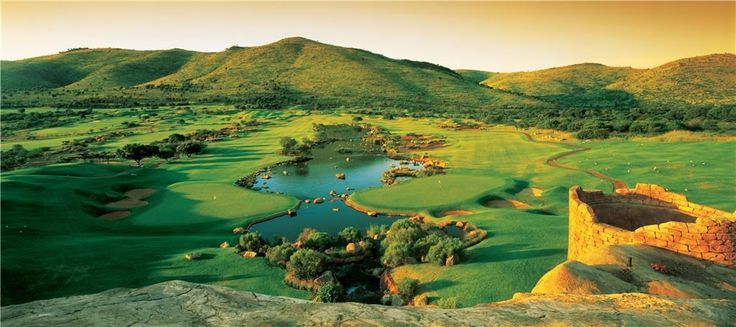 The view of the 9th and 18th holes from on top of the clubhouse of the Lost City Golf Course