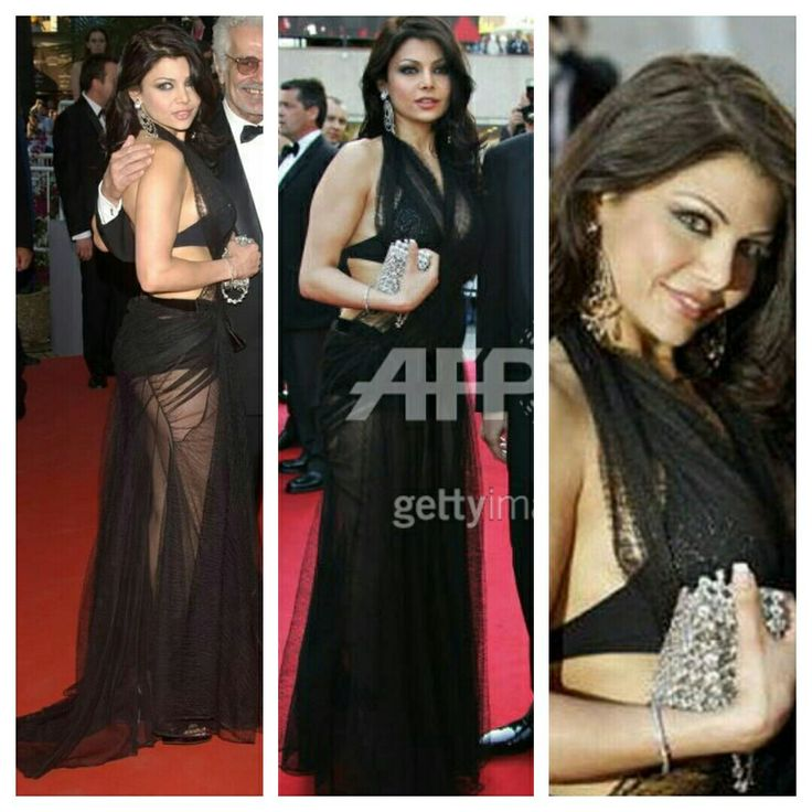 Haifa Wehbe  - look like a black transparet dress with a black bikini, - the earings and the clutch don't look good together or together with the dress