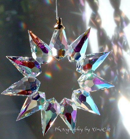 Bohemian Crystal Prism Star SunCatcher makes rainbows on the walls.