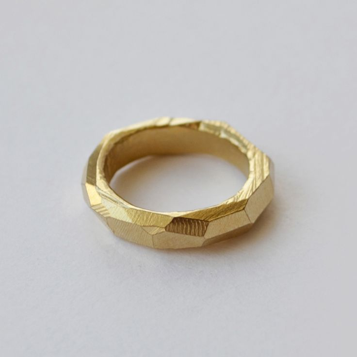 Faceted wedding band, handcrafted by Melbourne jewellery designer, Seb Brown