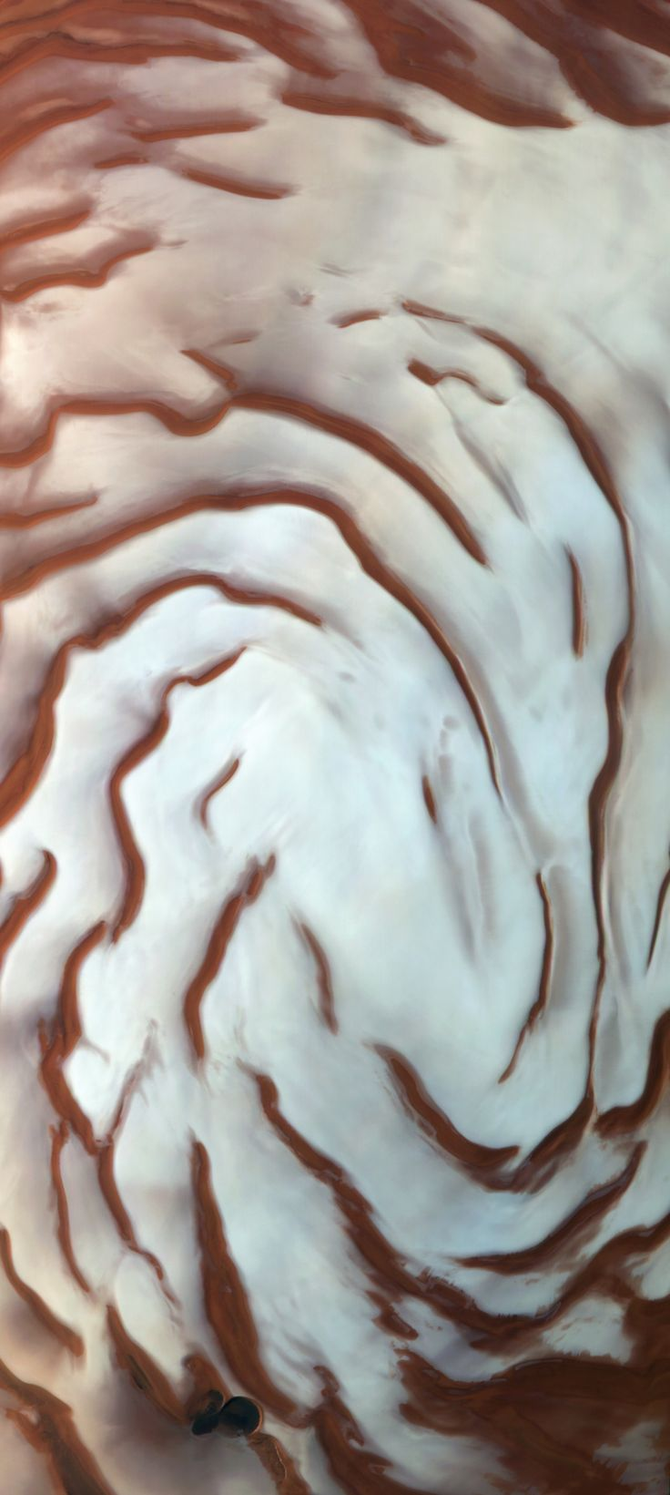 Boreales Scopuli - The north polar cap of Mars and the spiraling network of troughs, hundreds of meters deep, known as the Boreales Scopuli. The full cap is roughly 1000km across. Imaged by ESA's Mars Express orbiter.