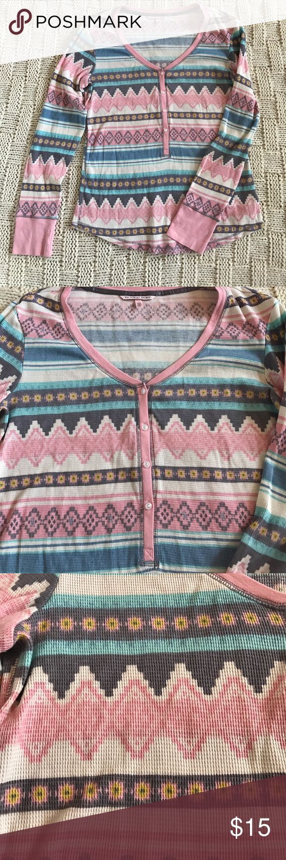 Victoria' Secret Thermal Top Adorable and soft tribal print Victoria's Secret Thermal Pajama top, size large. Pretty pastel colors (pink, yellow, blues, purple and cream) throughout shirt. 4 clear buttons halfway down Shirt. 98% cotton. Can be worn as a pajama top or as a regular top. I wore it as a regular top and got a lot of compliments but it's a little too big on me. Only worn once, like new condition! Victoria's Secret Tops Button Down Shirts