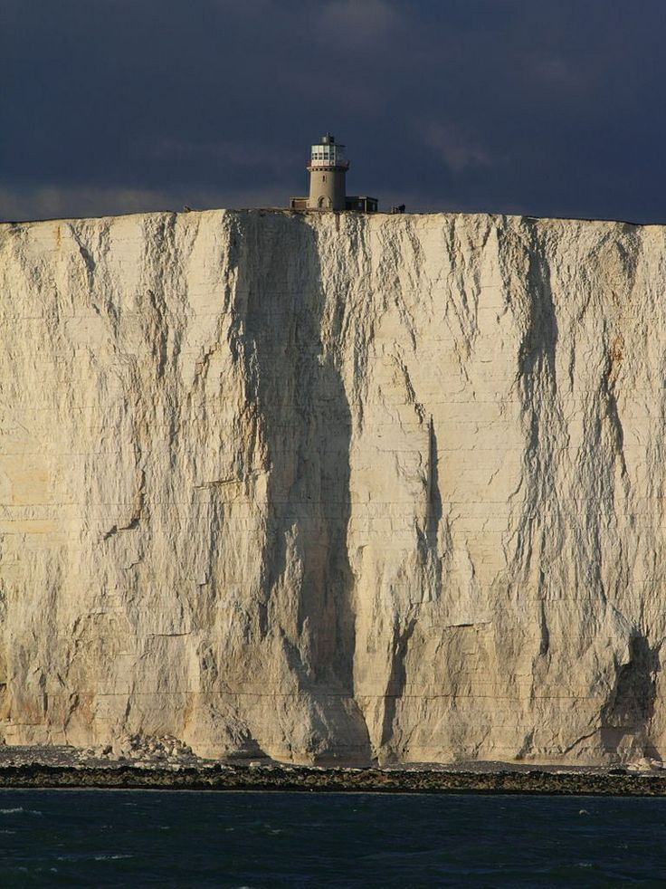 These white cliffs are formed entirely from marine microorganisms deposited hundreds of millions of years ago. Beachy Head, Sussex, Great Britain