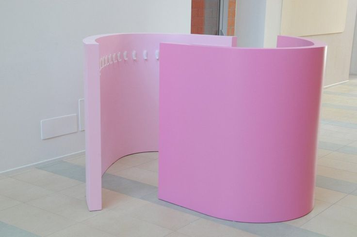Dress-up unit. Curved partitions with safety hooks for dressing up costume and materials and options for reinforced glass safety mirror.    Two units create a private space when overlapped.  Children feel enclosed, while adults can see over the partition wall to supervise.  Children enter, dress up and emerge transformed with a new identity!
