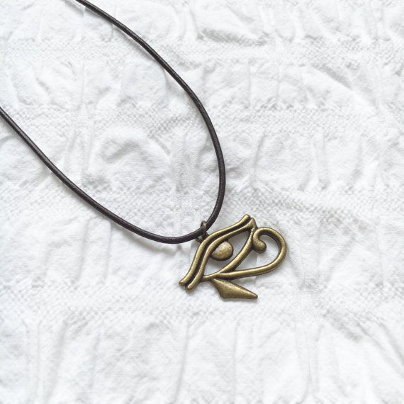Antique gold Eye of Horus leather necklace by JunkboxCouture