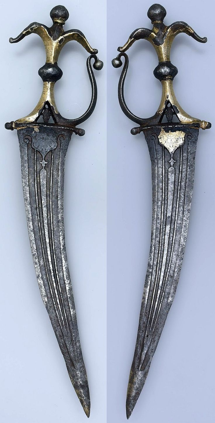 SOUTH INDIAN CHILLANUM DAGGER WITH SILVERED HILT 17TH CENTURY All steel construction, the hilt with integral knuckle guard, lobed finials and a pierced lower section, retains most of its silver covering. The gently recurving blade is beautifully decorated with chiselled elements and fullering. Areas of patination and pitting. This dagger dates to the 16th - 17th century.