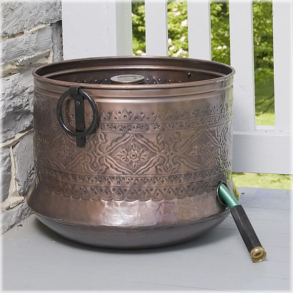 This is a CobraCo® Embossed Hose Holder.  It is the perfect place to 'hide' your unsightly hose!  I want one to hide mine.  It's a great talking point, and really doesn't look like a hose holder!        Find one for your garden at:http://www.avantgardendecor.com/store/accent-decor/hheirn