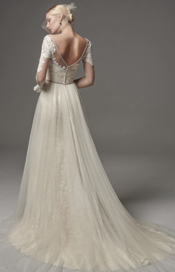 Romantic sheer lace embroidered long-sleeve tulle skirt wedding dress; Featured Dress: Maggie Sottero