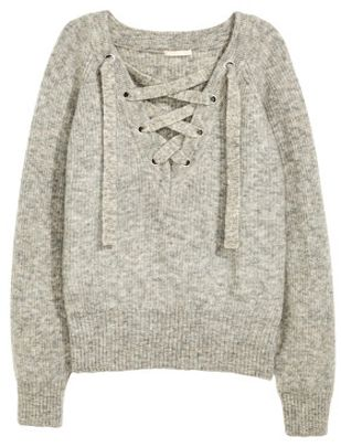 $59, h&m    This spin-off of Isabel Marant's lace-up knit is seriously good!       1. H&M lace-up merino swe ater , $59 , hm. com  2. Vic...