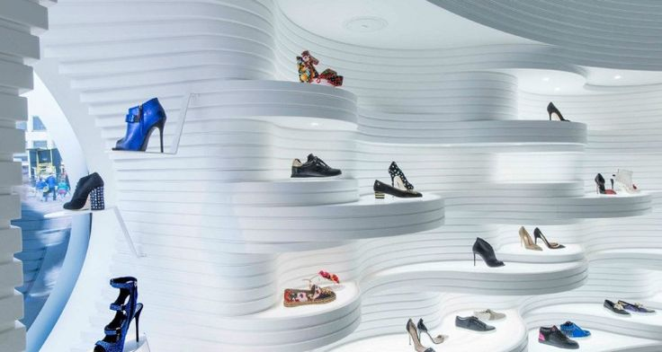 """Shoebaloo, Koningsplein Interior High-end fashion retailers Shoebaloo enlisted MVSA architects to modify their display in their Koningsplein branch. The googly layers of plastic undulate within the shop floor, hiding and revealing certain products as you walk through the store. The concept was meant to be a unique one to """"suite the brand"""", and the aim …"""