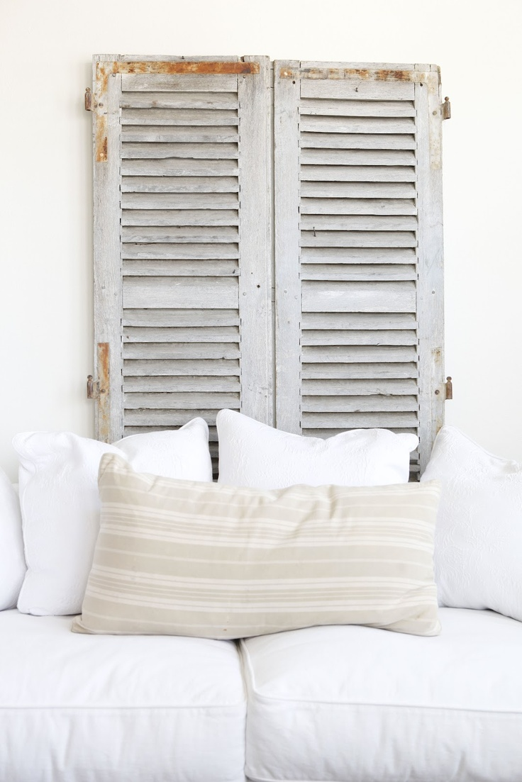 old shutters behind a couch   |   DustyLu Interiors