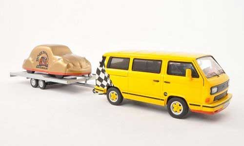 Premium ClassiXXs 1:43 VW T3 Diecast Model Van PRE13057 This VW T3 B Bus plus Trailer Carrying Covered Beetle Diecast Model Van is Yellow and has working wheels and also comes in a display case. It is made by Premium ClassiXXs and is 1:43 scale (approx. 10cm / 3.9in long). This model of VW's T3 features colour-coded alloy wheels and is towing a VW Beetle on a trailer. #PremiumClassiXXs #ModelVan #VW