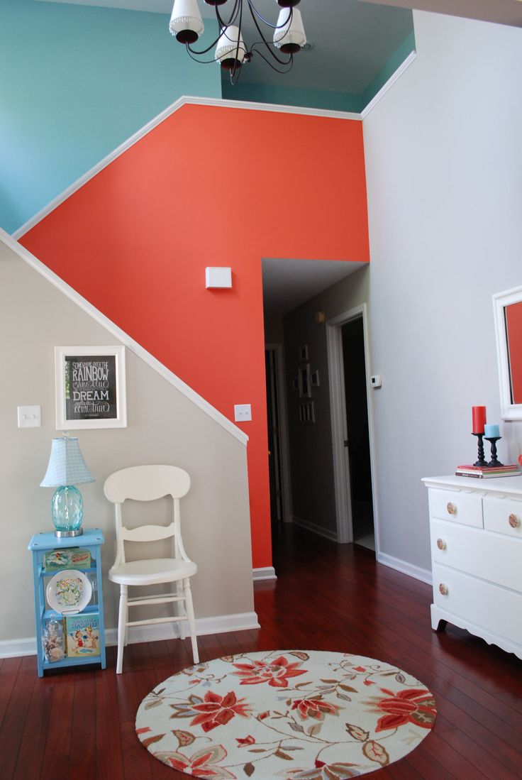 Aqua and Coral accent walls on stairs with Benjamin Moore Revere Pewter in foyer.