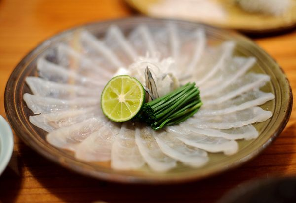 Fugu Sashimi is a sashimi dish consisting of fresh and raw puffer fish meat sliced into thin pieces.
