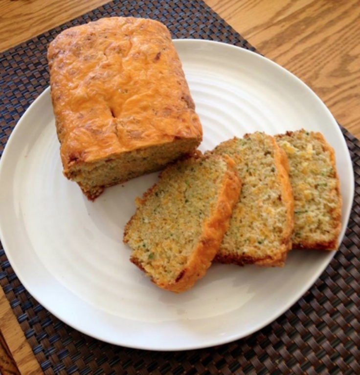 Cathy Mendes slices up our Sharp Cheddar-Zucchini Bread on a pretty white platter.