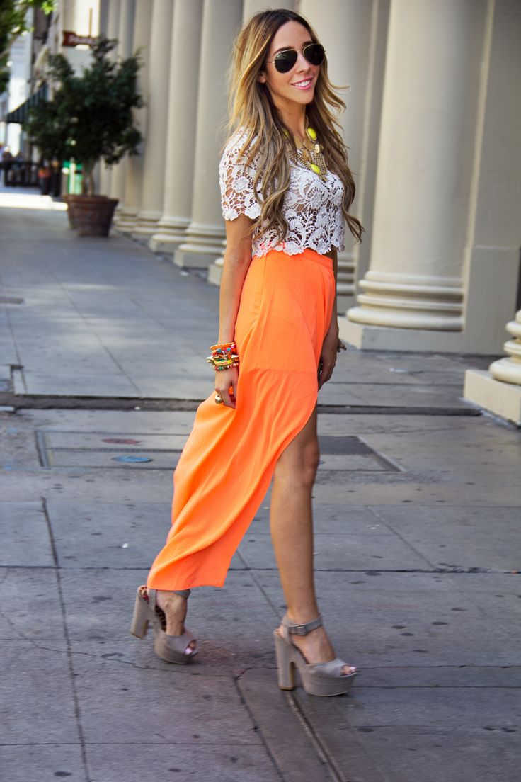 white crop top and orange high low skirt i think this is