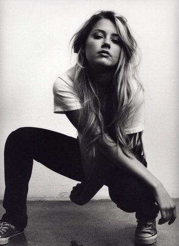 Amber Heard from Friday Night Lights. Sometimes she resembles the stunning Scarlett Johansson.