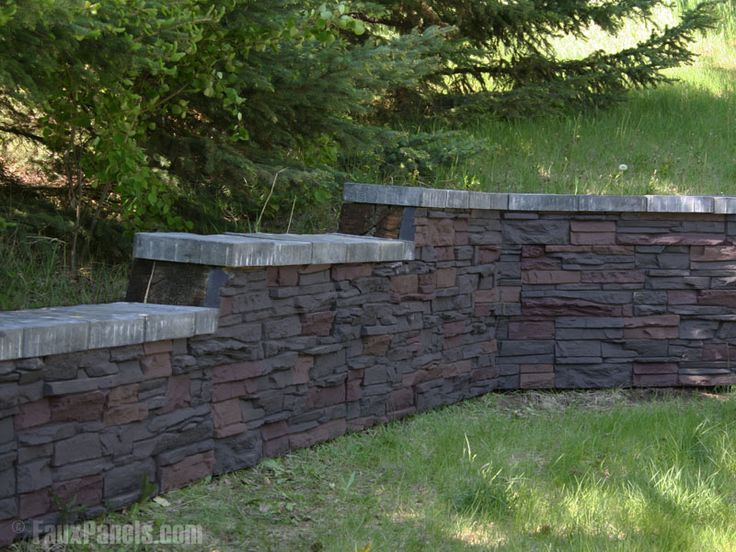 Graduating Retaining Wall Fitted With Artificial Stone Paneling