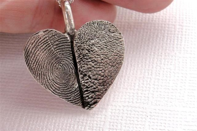 fingerprint and paw print heart | Found on etsy.com