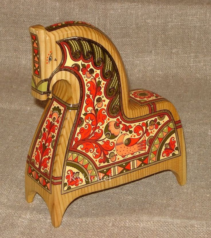 Traditional Russian toy – a handmade wooden horse, decorated with folk painting from Northern Russia. #folk #art #Russian #toy