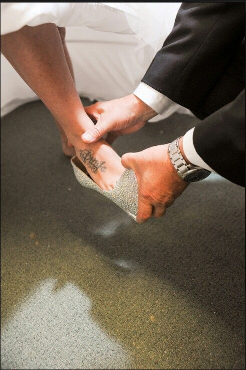 Portuguese Wedding tradition. Father putting his daughter shoes..... Love