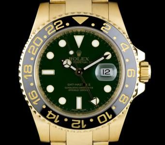 Rolex GMT-Master II Gents 18k Yellow Gold Green Dial Black Bezel 116718LN