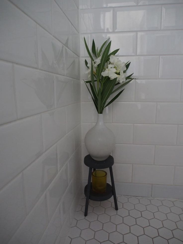 Beveled edge subway tiles, mosaic floor tiles.