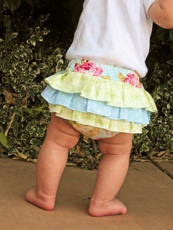 ruffled nappy covers - sewn into the back seams, not on top of the cover.