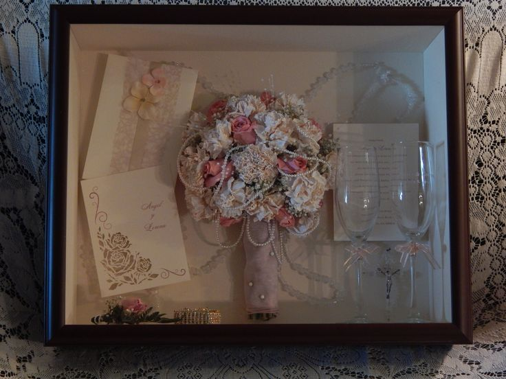A homemade bouquet preserved with all the wedding memorabilia. forgetmenevers.com