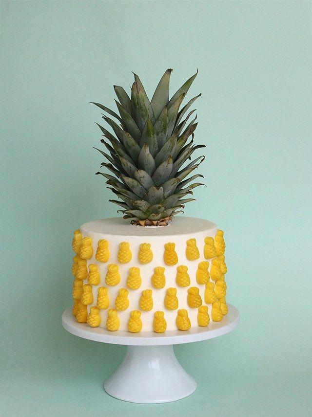 Pineapple cake decorated with Sugarfina candies.