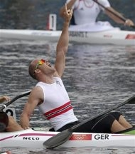 Eirik Veras Larsen of Norway celebrates after finishing first in the Final A of men's kayak single (K1) 1000m final at Eton Dorney at the London 2012 Olympics Games August 8, 2012.