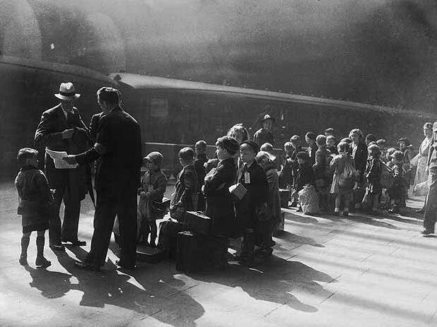 Evacuees, made up mostly of children, prepare to leave WWII Liverpool.