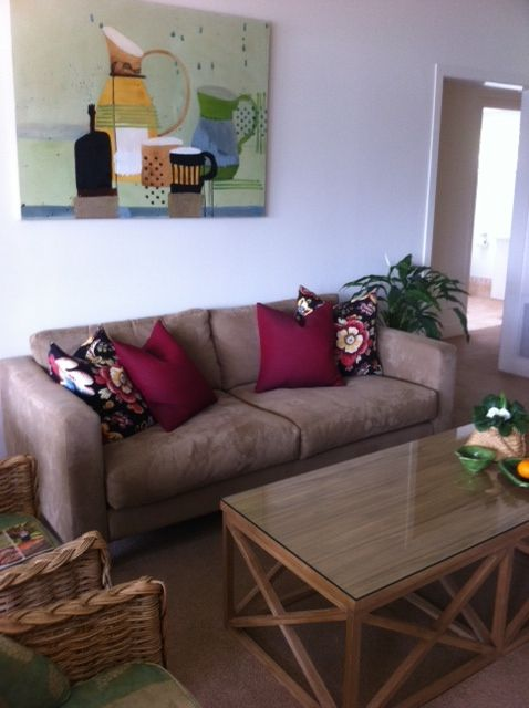 Using existing pieces of the homeowners I added new cushions and coffee table to update their look. Renovation Takapuna #renovation #interiordeisgn #designers #art #flowers #cushions #warwickfabrics #wicker #texture #wood