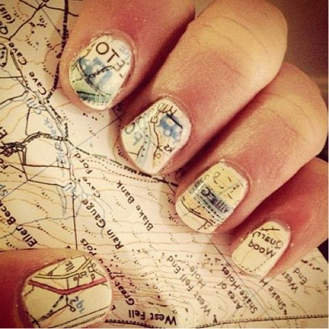 How to do this: Paint your nails white/cream and let dry. Soak nails in rubbing alcohol for five minutes, then press down on map, newsprint or patterned scrapbook paper. The design will rub off onto nails.