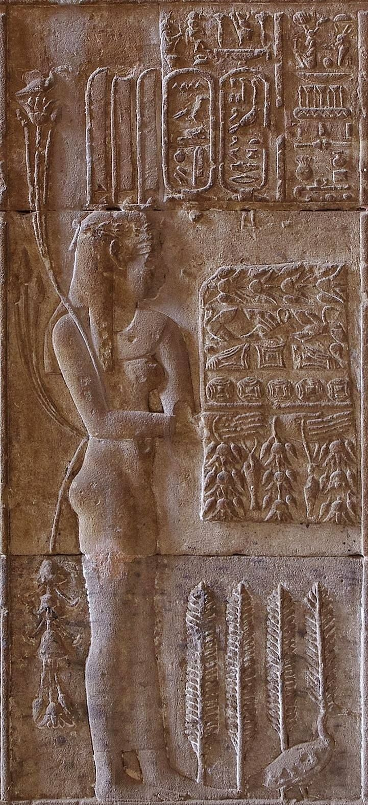Temple of the Goddess Hathor at Nitentóre (Dendera), detail from the procession represented on the lower frieze of the Hypostyle Hall: Sekhet, the Goddess of the Fields, bringing loaves, birds and flowers