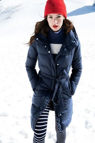 It also works for stripes! A lighter layer would also work in the place of a puffer, as long as it's cinched in the middle and of a longer length. Photo: Via J.Crew