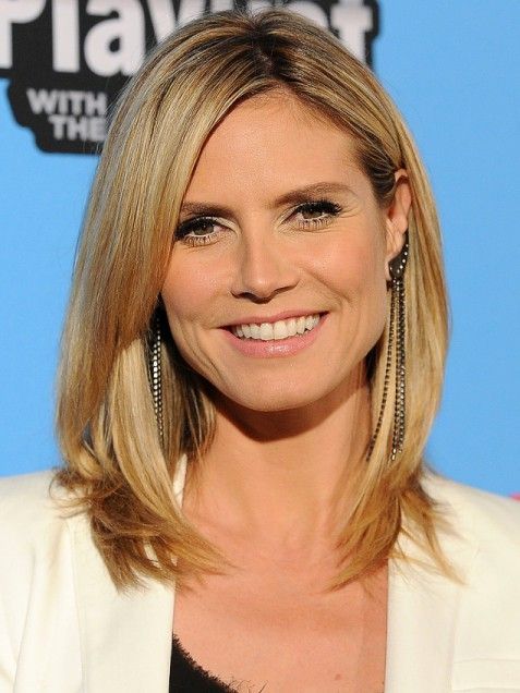 Sure, she's equal parts supermodel and super-mom, but Heidi Klum's long bob is one hairstyle that looks just as gorgeous with almost every face shape. Off-center bangs that sweep in in at her cheekbone emphasize her enviable bone structure. via @stylelist