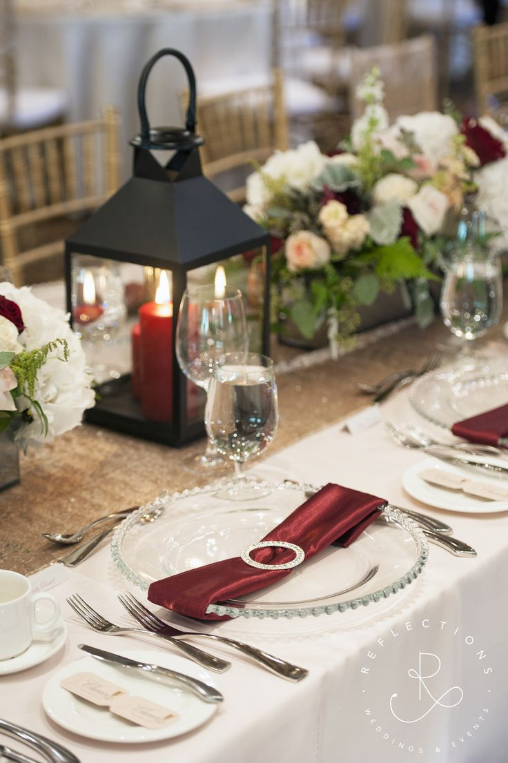 Ivory, blush and burgundy wedding decor with lantern and ...