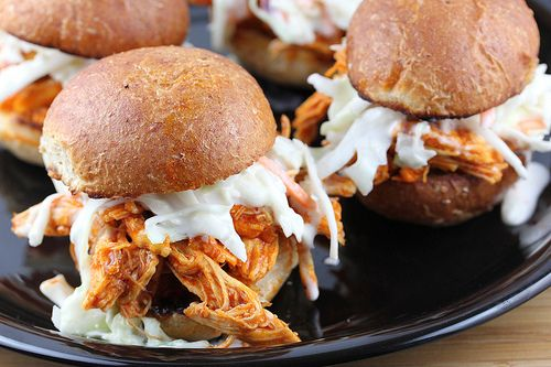 Buffalo Chicken Sliders : shredded chicken tossed with buffalo sauce.  Mix bag of coleslaw with ranch dressing and top on a bun with buffalo chicken mixture.