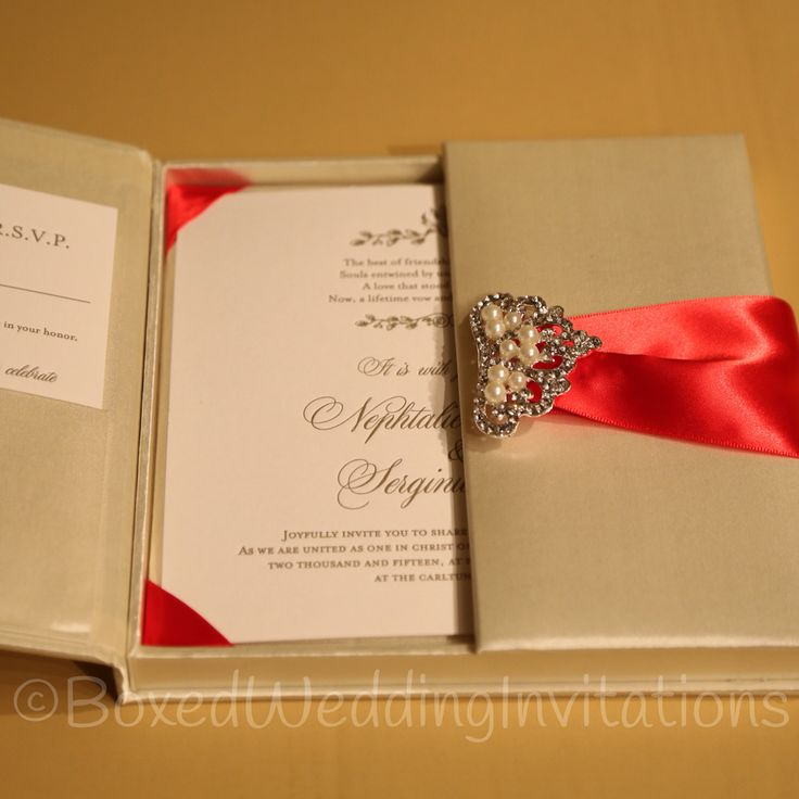 Beautiful boxed wedding invitations in ivory red