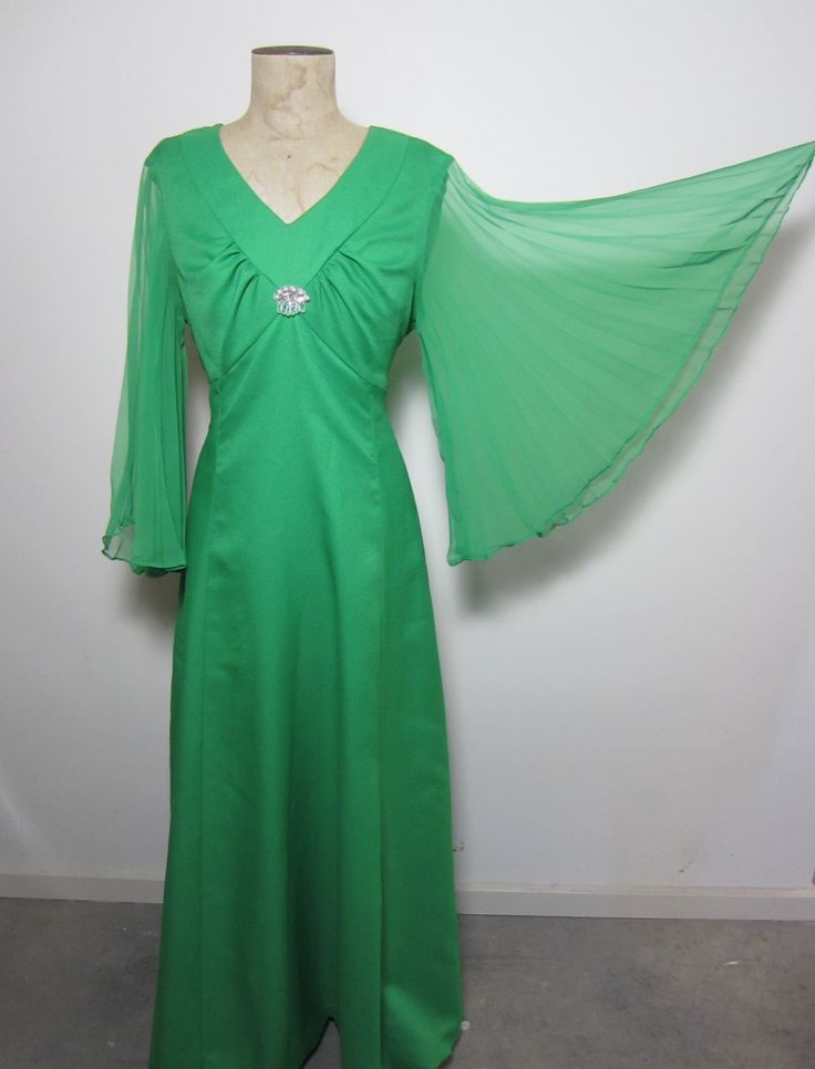 Emerald green 70s evening gown with jewel detail and concertina pleated sleeves