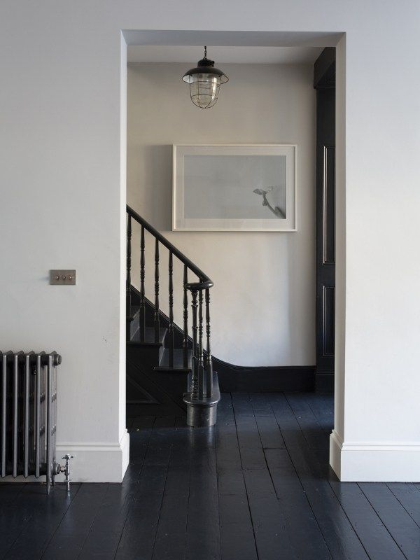 Classy Black Painted Wood Floor With Stark Contrast White
