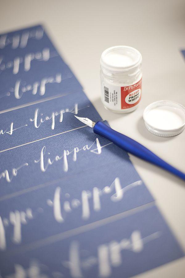 offbeat white ink calligraphy on dark navy blue paper