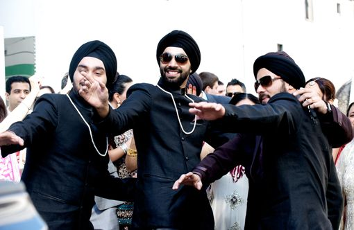 Washington D.C. Indian Elephant Baraat with groomsmen in black on IndianWeddingSite.com