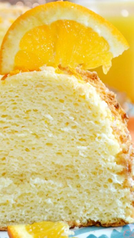 Orange Sponge Cake ~ Light-as-air, delicious cake, finished with thick, bright orange glaze and grated orange rind.