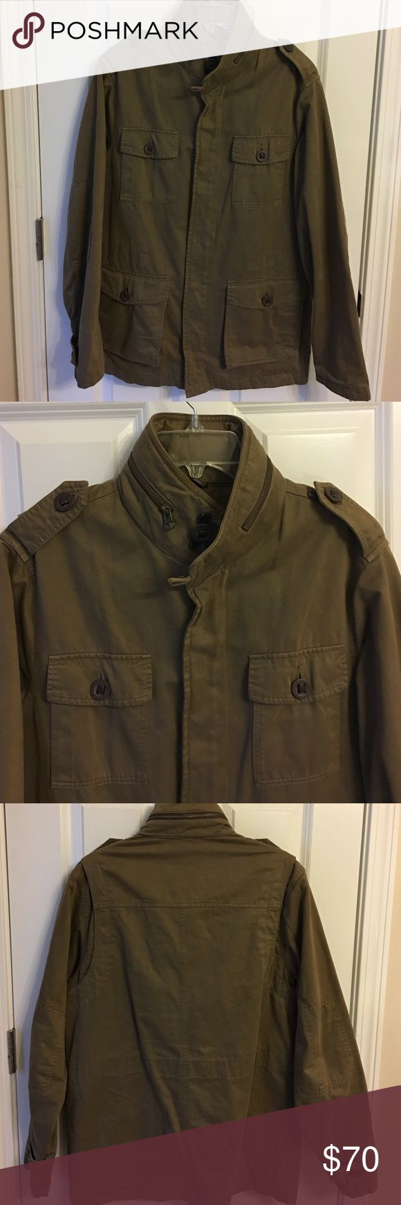 Tasso Elba men's jacket Olive green. Adjustable drawstring waist. Lightly used, looks brand new. Has a hood that comes out of zipper around the neck Tasso Elba Jackets & Coats Lightweight & Shirt Jackets