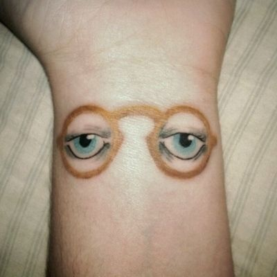 tattoos -                                                      the eyes of Dr. T.J. Eckleburg ( 49 other literary tattoos under the link)