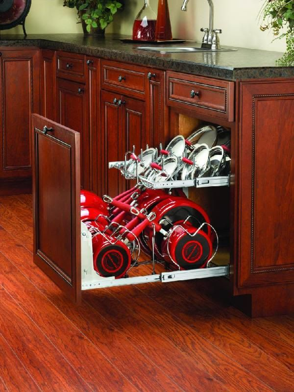 Has anyone ever used this kind of pots/pans storage? What is your opinion of the use of space? I am considering using this pullout in a 24 inch cabinet. Here is a link that might be useful: Rev A Shelf